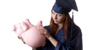 Graduate-Holding-Empty-Piggy-Bank