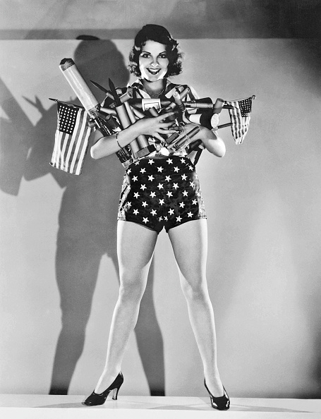 MGM actress Lillian Bond with an armload of fireworks for a Fourth of July celebration, Hollywood, California, late 1920s or early 1930s. (Photo by Underwood Archives/Getty Images)
